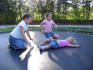 a child enjoying time on a trampoline